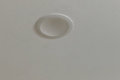 Install an LED downlight and enlarge hole in the ceiling with a clever jig to keep the hole saw centralised